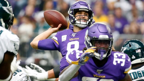<p>               Minnesota Vikings quarterback Kirk Cousins, center, throws a pass during the first half of an NFL football game against the Philadelphia Eagles, Sunday, Oct. 13, 2019, in Minneapolis. (AP Photo/Bruce Kluckhohn)             </p>