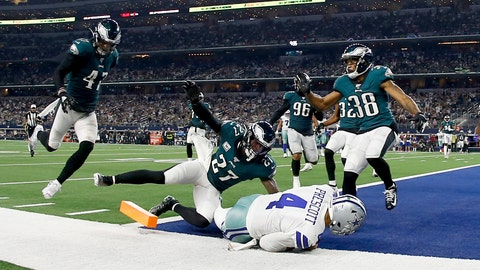 <p>               Dallas Cowboys quarterback Dak Prescott (4) reaches the end zone for a touchdown as Philadelphia Eagles' Nate Gerry (47), Malcolm Jenkins (27), and Orlando Scandrick (38) defend in the second half of an NFL football game in Arlington, Texas, Sunday, Oct. 20, 2019. (AP Photo/Ron Jenkins)             </p>