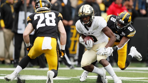 <p>               Purdue wide receiver David Bell, center, catches a pass between Iowa defenders Jack Koerner, left, and Matt Hankins, right, during the first half of an NCAA college football game, Saturday, Oct. 19, 2019, in Iowa City, Iowa. (AP Photo/Charlie Neibergall)             </p>