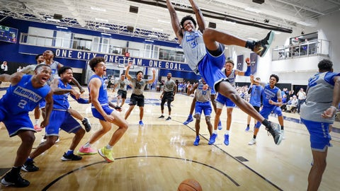 <p>               In this Sept. 24, 2019, photo, Memphis center James Wiseman dunks as his teammates celebrate during an open practice for the NCAA college basketball team in front of the Rebounders Club in Memphis, Tenn. Wiseman was selected as a member of The Associated Press preseason All-America team Tuesday, Oct. 22. (Mark Weber/Daily Memphian via AP)             </p>