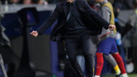 <p>               Atletico Madrid's head coach Diego Simone celebrates after Atletico Madrid's Alvaro Morata scoring the opening goal during the Champions League Group D soccer match between Atletico Madrid and Bayer Leverkusen at Wanda Metropolitano stadium in Madrid, Spain, Tuesday, Oct. 22, 2019. (AP Photo/Bernat Armangue)             </p>