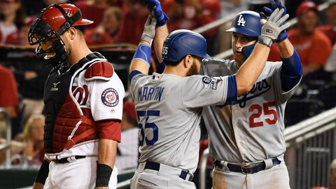 <p>               Los Angeles Dodgers' Russell Martin (55) celebrates with David Freese (25) after hitting a two-run home run off Washington Nationals relief pitcher Hunter Strickland during the ninth inning in Game 3 of a baseball National League Division Series on Sunday, Oct. 6, 2019, in Washington. At left is Nationals catcher Kurt Suzuki. (AP Photo/Susan Walsh)             </p>