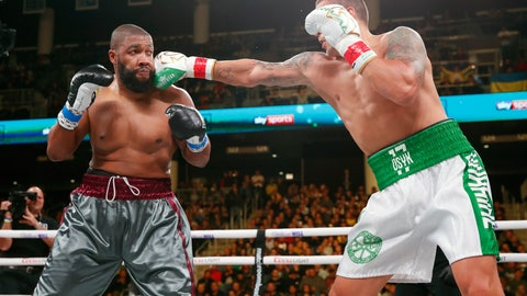 <p>               Oleksandr Usyk, right, hits Chazz Witherspoon during a heavyweight boxing bout Saturday, Oct. 12, 2019, in Chicago. (AP Photo/Kamil Krzaczynski)             </p>