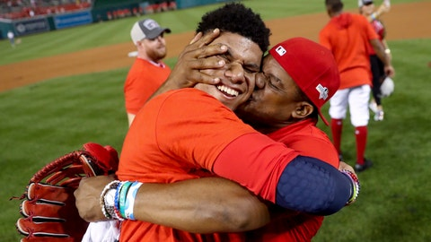 <p>               Washington Nationals' Juan Soto gets a kiss from his father, Juan Jose Soto, right, after defeating the Milwaukee Brewers 4-3 in a National League wild-card baseball game at Nationals Park, Tuesday, Oct. 1, 2019, in Washington. (AP Photo/Andrew Harnik)             </p>