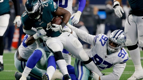 <p>               Philadelphia Eagles running back Jordan Howard (24) attempts to break through a tackle by Dallas Cowboys' Trysten Hill (97) in the second half of an NFL football game in Arlington, Texas, Sunday, Oct. 20, 2019. (AP Photo/Michael Ainsworth)             </p>