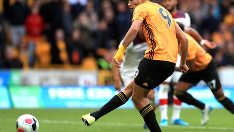 <p>               Wolverhampton Wanderers' Raul Jimenez scores his side's first goal from the penalty spot, during the English Premier League soccer match between Wolverhampton Wanderers and Southampton at Molineux in Wolverhampton, England, Saturday Oct. 19, 2019. (Mike Egerton/PA via AP)             </p>