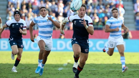 <p>               United States' Blaine Scully, right, and Argentina's Santiago Carreras chase the ball during the Rugby World Cup Pool C game at Kumagaya Rugby Stadium between Argentina and the United States in Kumagaya City, Japan, Wednesday, Oct. 9, 2019. (AP Photo/Eugene Hoshiko)             </p>