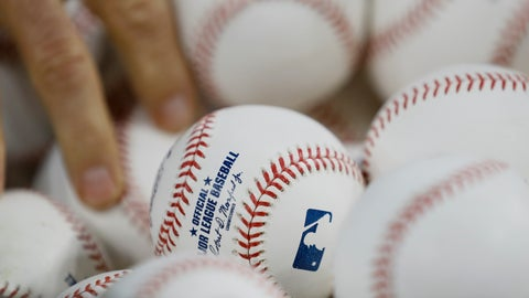 <p>               A Washington Nationals player reaches for a ball during batting practice before Game 2 of the baseball World Series against the Houston Astros Wednesday, Oct. 23, 2019, in Houston. (AP Photo/Matt Slocum)             </p>