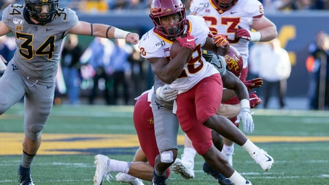 <p>               Iowa State running back Breece Hall (28) escape the tackle of West Virginia safety Tykee Smith (23) during the first half of an NCAA college football game Saturday, Oct. 12, 2019, in Morgantown, W.Va. (AP Photo/Raymond Thompson)             </p>