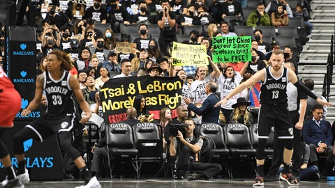 <p>               People raise signs referencing Tibet and Hong Kong during the fourth quarter of a preseason NBA basketball game between the Toronto Raptors and the Brooklyn Nets, Friday, Oct. 18, 2019, in New York. (AP Photo/Sarah Stier)             </p>