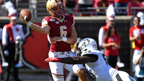 <p>               Boston College quarterback Dennis Grosel (6) attempts to get rid of the ball before being brought down by Louisville defensive lineman Amonte Caban (53) during the first half of an NCAA college football game in Louisville, Ky., Saturday, Oct. 5, 2019. (AP Photo/Timothy D. Easley)             </p>
