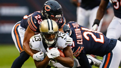 <p>               New Orleans Saints wide receiver Michael Thomas (13) its tackled by Chicago Bears strong safety Ha Ha Clinton-Dix (21) and cornerback Kyle Fuller (23) during the first half of an NFL football game in Chicago, Sunday, Oct. 20, 2019. (AP Photo/Charles Rex Arbogast)             </p>
