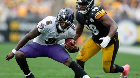 <p>               Baltimore Ravens quarterback Lamar Jackson (8) scrambles away from Pittsburgh Steelers inside linebacker Vince Williams (98) in the second half of an NFL football game, Sunday, Oct. 6, 2019, in Pittsburgh. (AP Photo/Don Wright)             </p>