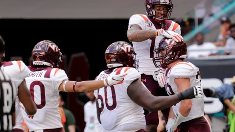 <p>               Virginia tight end Dalton Keene, right, celebrates with wide receiver Damon Hazelton, top right, and other teammates after scoring a touchdown during the first half of an NCAA college football game against Miami, Saturday, Oct. 5, 2019, in Miami Gardens, Fla. (AP Photo/Lynne Sladky)             </p>