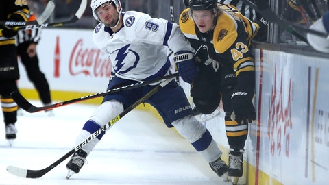 <p>               Tampa Bay Lightning center Tyler Johnson (9) and Boston Bruins left wing Danton Heinen (43) compete for the puck during the first period of an NHL hockey game Thursday, Oct. 17, 2019, in Boston. (AP Photo/Elise Amendola)             </p>