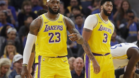 <p>               Los Angeles Lakers forward LeBron James (23) reacts in front of forward Anthony Davis (3) during the first half of a preseason NBA basketball game against the Golden State Warriors in San Francisco, Saturday, Oct. 5, 2019. (AP Photo/Jeff Chiu)             </p>