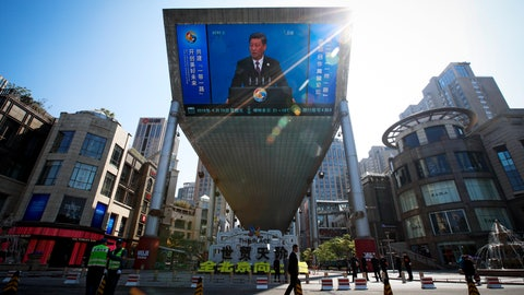 <p>               FILE - In this April 26, 2019, file photo, traffic warden and securities stand guard near a TV screen broadcasting live of President Xi Jinping's opening speech, outside a shopping mall in Beijing. Companies who do business with China walk a fine line to stay aligned with U.S. values such as freedom of speech and democracy while avoiding offending China, where they stand to make billions of dollars. (AP Photo/Andy Wong, File)             </p>