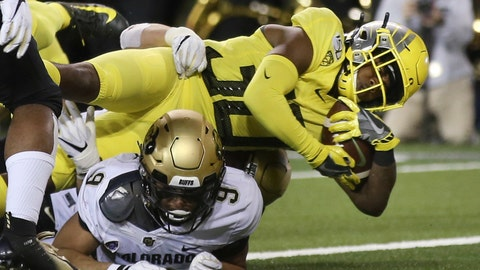 <p>               Oregon's Jaylon Redd, top, dives into the end zone for a touchdown over Colorado's Aaron Maddox during the second quarter of an NCAA college football game Friday, Oct. 11, 2019, in Eugene, Ore. (AP Photo/Chris Pietsch)             </p>