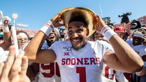 <p>               Oklahoma quarterback Jalen Hurts (1) puts on the Golden Hat after beating Texas 34-27 in an NCAA college football game at the Cotton Bowl, Saturday, Oct. 12, 2019, in Dallas. (AP Photo/Jeffrey McWhorter)             </p>
