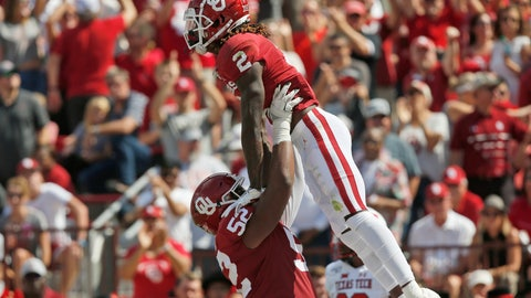 <p>               Oklahoma offensive lineman Tyrese Robinson (52) celebrates with teammate CeeDee Lamb (2) follow a touchdown by Lamb in the second quarter of an NCAA college football game against Texas Tech in Norman, Okla., Saturday, Sept. 28, 2019. (AP Photo/Sue Ogrocki)             </p>