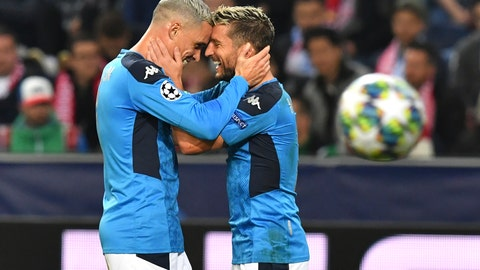 <p>               Napoli's Dries Mertens, right, celebrates with teammate Napoli's Jose Callejon after scoring his side's second goal during the Champions League Group E soccer match between FC Red Bull Salzburg and Napoli in Salzburg, Austria, Wednesday, Oct. 23, 2019. (AP Photo/ Kerstin Joensson)             </p>