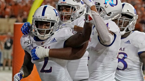 <p>               Kansas' Daylon Charlot (2) celebrates with teammates after catching a 2-point conversion during the second half of the team's NCAA college football game against Texas in Austin, Texas, Saturday, Oct. 19, 2019. (AP Photo/Chuck Burton)             </p>