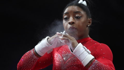 <p>               Simone Biles of the United States chalks her hands prior to her performance on the uneven bars in the women's apparatus finals at the Gymnastics World Championships in Stuttgart, Germany, Saturday, Oct. 12, 2019. (AP Photo/Matthias Schrader)             </p>