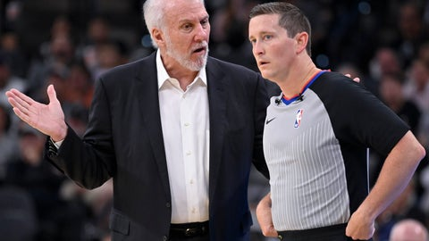 <p>               San Antonio Spurs head coach Gregg Popovich, left, talks to referee Nick Buchert during the first half of an NBA preseason basketball game against the New Orleans Pelicans, Sunday, Oct. 13, 2019, in San Antonio. (AP Photo/Darren Abate)             </p>