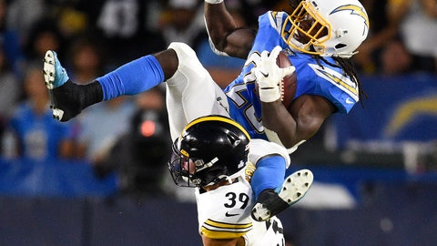 <p>               Los Angeles Chargers running back Melvin Gordon, top, is tripped up by Pittsburgh Steelers free safety Minkah Fitzpatrick as he runs the ball during the first half of an NFL football game, Sunday, Oct. 13, 2019, in Carson, Calif. (AP Photo/Kelvin Kuo)             </p>