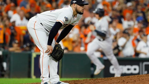 <p>               Houston Astros relief pitcher Roberto Osuna reacts after giving up a two-run home run to New York Yankees' DJ LeMahieu during the ninth inning in Game 6 of baseball's American League Championship Series Saturday, Oct. 19, 2019, in Houston. (AP Photo/Matt Slocum)             </p>