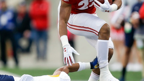<p>               Wisconsin running back Jonathan Taylor runs past Kent State safety Elvis Hines during the first half of an NCAA college football game Saturday, Oct. 5, 2019, in Madison, Wis. (AP Photo/Andy Manis)             </p>
