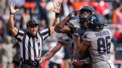 <p>               Illinois' Josh Imatorbhebhe, second from right, celebrates with teammates including Donny Navarro (86) after scoring a touchdown in the second half of an NCAA college football game against Wisconsin, Saturday, Oct.19, 2019, in Champaign, Ill. Illinois won 24-21. (AP Photo/Holly Hart)             </p>