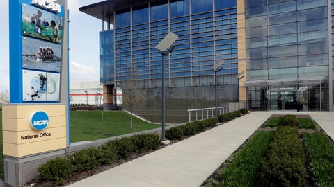 """<p>               FILE - This is an April 25, 2018, file photo, showing NCAA headquarters in Indianapolis. The NCAA Board of Governors took the first step Tuesday, Oct. 29, 2019, toward allowing athletes to cash in on their fame, voting unanimously to clear the way for the amateur athletes to """"benefit from the use of their name, image and likeness."""" The United States' largest governing body for college athletics realized that it """"must embrace change to provide the best possible experience for college athletes,"""" the board said in a news release issued after the vote at Emory University in Atlanta. (AP Photo/Darron Cummings, File)             </p>"""