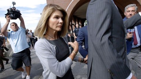 <p>               FILE - In this Aug. 27, 2019 file photo, actress Lori Loughlin departs federal court in Boston after a hearing in a nationwide college admissions bribery scandal.  Loughlin, her fashion designer husband, Mossimo Giannulli, and nine other parents face new charges in the college admissions scandal. Federal prosecutors announced Tuesday, Oct. 22, 2019, that the parents were indicted on charges of conspiracy to commit federal program bribery.  (AP Photo/Steven Senne, File)             </p>