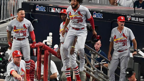 <p>               St. Louis Cardinals players celebrate St. Louis Cardinals Marcell Ozuna hit of a two RBI double in the ninth inning during Game 1 of a best-of-five National League Division Series against the Atlanta Braves, Thursday, Oct. 3, 2019, in Atlanta. (AP Photo/Scott Cunningham)             </p>