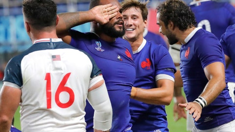 <p>               France's Jefferson Poirot, centre, celebrates after scoring a try during the Rugby World Cup Pool C game at Fukuoka Hakatanomori Stadium between France and the United States in Fukuoka, Japan, Wednesday, Oct. 2, 2019. France defeated the United States 33-9. (AP Photo/Christophe Ena)             </p>