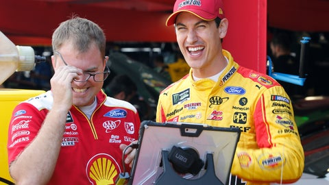 <p>               Joey Logano, right, shares a laugh with a crew member in the garage at Martinsville Speedway In Martinsville, Va., Saturday, Oct. 26, 2019. Elliott had an engine failure less than five minutes into the opening practice for the third round of NASCAR's playoffs. (AP Photo/Steve Helber)             </p>