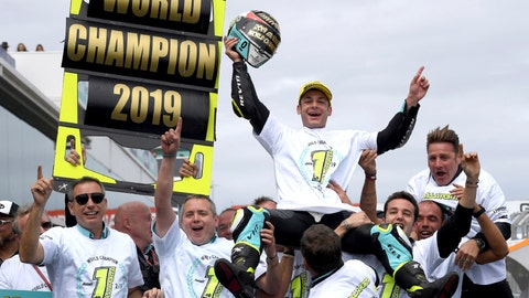 <p>               Italian rider Lorenzo Dalla Porta of Leopard Racing Team celebrates with his team crew after claiming the Moto3 world championship at the Australian Motorcycle Grand Prix at Phillip Island, near Melbourne, Australia, Sunday, Oct. 27, 2019. (AP Photo/Andy Brownbill)             </p>