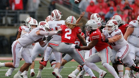 <p>               Ohio State defenders Chase Young (2) and Tyreke Smith (11) cause Wisconsin quarterback Jack Coan to fumble the ball on fourth down during the second half of an NCAA college football game Saturday, Oct. 26, 2019, in Columbus, Ohio. Ohio State beat Wisconsin 38-7. (AP Photo/Jay LaPrete)             </p>