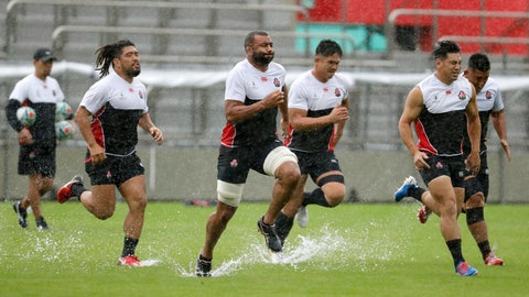 <p>               Japan's rugby team players practice ahead of their match against Scotland as Typhoon Hagibis approaches Saturday, Oct. 12, 2019. Tokyo and surrounding areas braced for a powerful typhoon forecast as the worst in six decades, with streets and trains stations unusually quiet Saturday as rain poured over the city. (Yuki Sato/Kyodo News via AP)             </p>