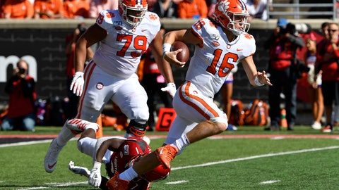 <p>               Clemson quarterback Trevor Lawrence (16) escapes from the grasp of Louisville linebacker Monty Montgomery (7) during the second half of an NCAA college football game in Louisville, Ky., Saturday, Oct. 19, 2019. Clemson won 45-10. (AP Photo/Timothy D. Easley)             </p>