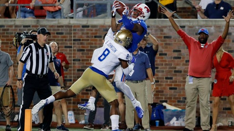 <p>               SMU wide receiver James Proche, top,, catches a touchdown pass while Tulsa safety Brandon Johnson (8) defends during the third overtime of an NCAA college football game Saturday, Oct. 5, 2019, in Dallas. SMU won 43-37. (AP Photo/Roger Steinman)             </p>