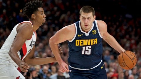 <p>               Denver Nuggets center Nikola Jokic dribbles past Portland Trail Blazers center Hassan Whiteside during the first half of an NBA basketball game in Portland, Ore., Wednesday, Oct. 23, 2019. (AP Photo/Craig Mitchelldyer)             </p>