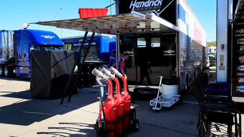 <p>               A crew member for JTG Daugherty Racing enters a back up hauler from Hendrick Motorsports during practice for a NASCAR Cup Series auto race at Kansas Speedway in Kansas City, Kan., Friday, Oct. 18, 2019. The JTG race team had to switch haulers after an accident on the way to Kansas Speedway rendered their hauler unusable. (AP Photo/Orlin Wagner)             </p>