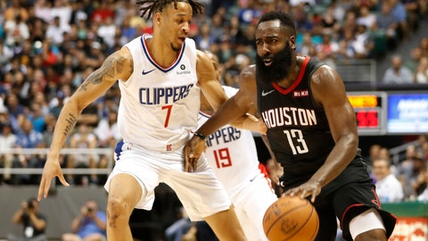 <p>               Los Angeles Clippers shooting guard Amir Coffey (7) guards Houston Rockets shooting guard James Harden (13) during the second quarter of an NBA preseason basketball game, Thursday, Oct 3, 2019, in Honolulu. (AP Photo/Marco Garcia)             </p>
