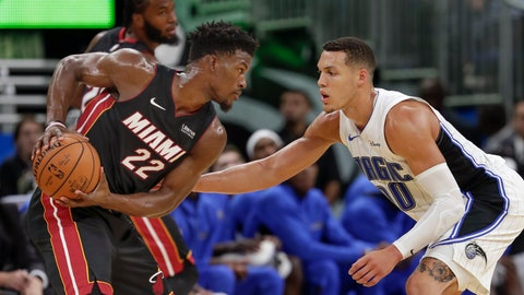 <p>               Miami Heat's Jimmy Butler (22) looks to get past Orlando Magic's Aaron Gordon, right, during the second half of an NBA preseason basketball game, Thursday, Oct. 17, 2019, in Orlando, Fla. (AP Photo/John Raoux)             </p>