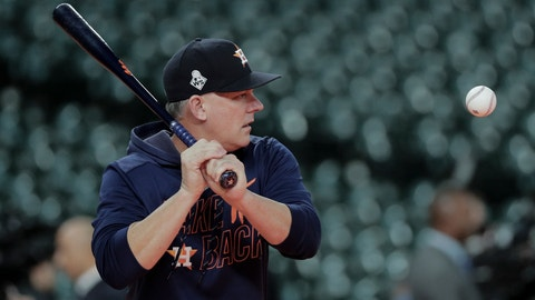 <p>               Houston Astros manager AJ Hinch hits balls during batting practice before Game 7 of the baseball World Series against the Washington Nationals Wednesday, Oct. 30, 2019, in Houston. (AP Photo/David J. Phillip)             </p>