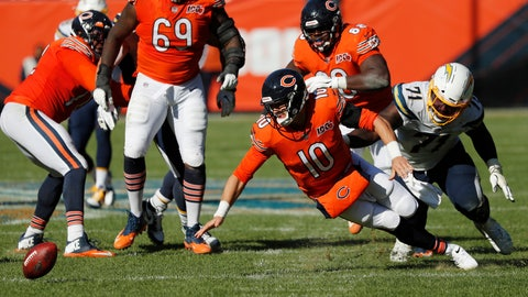 <p>               Chicago Bears quarterback Mitchell Trubisky (10) fumbles the ball in front of Los Angeles Chargers defensive end Damion Square (71) during the second half of an NFL football game, Sunday, Oct. 27, 2019, in Chicago. The Chargers won 17-16. (AP Photo/Charles Rex Arbogast)             </p>