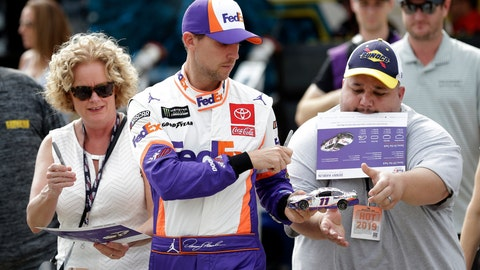 <p>               Denny Hamlin signs autographs during practice for Sunday's NASCAR Cup Series auto race at Charlotte Motor Speedway in Concord, N.C., Saturday, Sept. 28, 2019. (AP Photo/Gerry Broome)             </p>