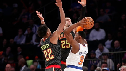 <p>               New York Knicks forward RJ Barrett (9) looks to pass with Atlanta Hawks forward Cam Reddish (22) and center Alex Len (25) defending during the first half of a preseason NBA basketball game in New York, Wednesday, Oct. 16, 2019. (AP Photo/Kathy Willens)             </p>